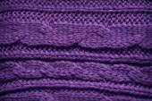 Texture of knitted garments purple — Stock Photo