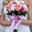 Bride holding wedding bouquet of beautiful — Stock Photo #65543631