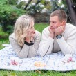 Couple hugging in a park seated in a bench — Stock Photo #66485741