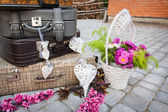 Decorations of hearts and suitcases with flowers — Stock Photo