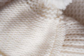 White knitted hat and scarf close up — Stock Photo