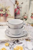 Two beautiful white cups and saucers — Stock Photo