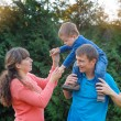 Happy family on walk in autumn park — Stock Photo #69721735