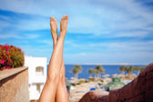 Beautiful legs of girl on a background of blue sky — Stockfoto