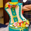 Beautiful wedding cake in turquoise colors with flowers and hat — Stock Photo #71042569