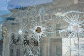 Bullet holes in the window of a shop in Dnepropetrovsk — Photo