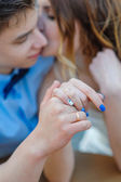 Hands of the bride and groom with gold rings — Stock Photo