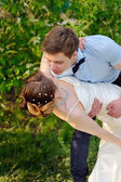 Bride and Groom at wedding Day walking Outdoors on spring in green park — Stock Photo