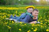 Father walking with his son on a flowering spring meadow — Stock Photo