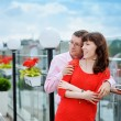 Lovely couple walking in an old European city center — Stock Photo #73151937