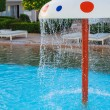 Fountain in the form of a mushroom in children's pool — Stock Photo #74812963