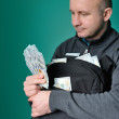Business Man Displaying a Spread of Cash — Stock Photo #75123739