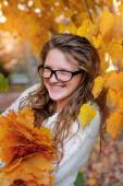 Portrait of beautiful woman wearing fashion glasses during the autumn — Stock Photo