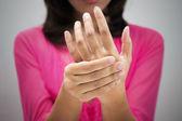 Acute pain in a women wrist — Stock Photo