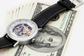 Clock and money close-up. Time is money concept — Stockfoto