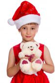Happy little girl in a red dress holding a white bear — Stock Photo