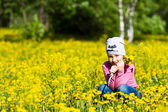 The girl collects dandelions — Stock Photo