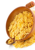 Corn flakes in bowl on white  — Stock Photo