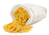Corn flakes in paper bag — Stock Photo