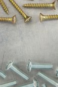 Bolts and screws at metal background — Stock Photo