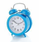 Alarm clock and school supplies on white background — Stock Photo