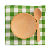 Wooden plate at checked napkin — Stock Photo