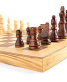 Chess figures on board at white  — Stock Photo