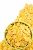 Corn flakes in bowl on white — Stock Photo