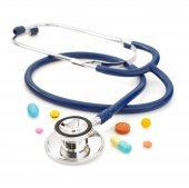 Medical stethoscope with pills on white  — Stock Photo
