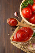 Tomato sauce on wood — Stock Photo