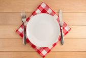 Kitchen utensils at cloth napkin — Stock Photo