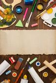Paint supplies and brush — Stockfoto