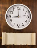 Wall clock with blank paper — Stock Photo