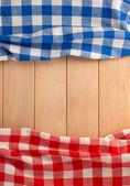 Napkins on wooden background — Stock Photo