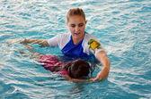 Child swimming pool lesson — Stock Photo