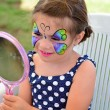 Little girl getting her face painted — Stock Photo #56126199