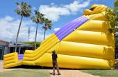 Worker inflate slide bouncy Castle — Stock Photo
