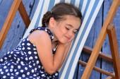 Little gir sleep in outdoor chair — Stock Photo