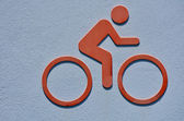 Icon of a person rids a bicycle — Stock Photo