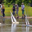 Постер, плакат: People racing remote control sailing wooden yachts