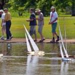 Постер, плакат: People racing remote control sailing wooden yachts