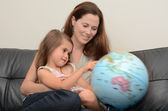 Mother and Child Search and Examining the Globe — Stock Photo