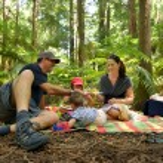 Family having a picnic outdoors in Rotorua — Stock Photo #62197489