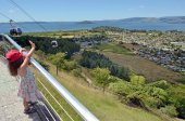 Girl waves to the Skyline Gondola Cableway in New Zealand — Stock Photo