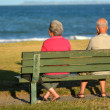 Mature couple sit on a bench — Stock Photo #63916577
