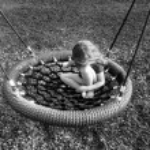 Sad girl on a swing at playground — Stock Photo #66434551
