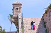 Arab couple visit at the walls of Akko — Stock Photo