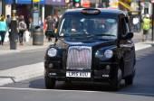 London black cab in Oxford street London UK — Stock Photo