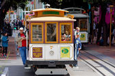 Passengers riding on Powell-Hyde line cable car in San Francisco — Stock Photo
