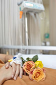 Flower and patient — Stock Photo